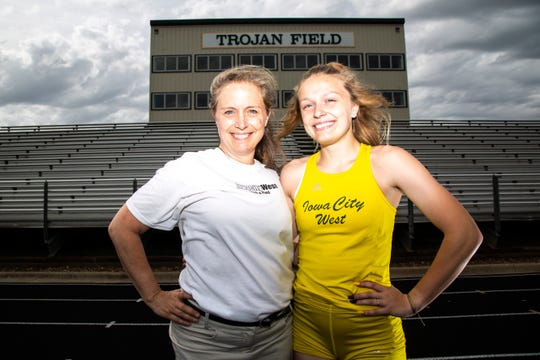 Iowa City West senior Peyton Steva, right, poses for a photo with her mother Peggy McGuire, Wednesday, May 22, 2019, at West High School in Iowa City, Iowa.