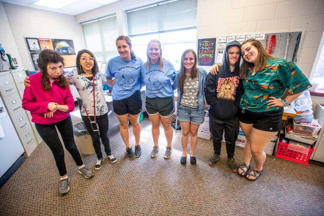 Graduating Best Buddies members pose for a photo, Wednesday, May 22, 2019, at City High School in Iowa City, Iowa.