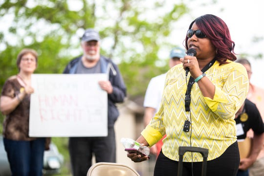 North Liberty City Councilor RaQuishia Harrington speaks while Golfview Mobile Home Court residents and community members hold a press conference following a 'town hall' with Havenpark Capitol representatives, Thursday, May 23, 2019, in North Liberty, Iowa.