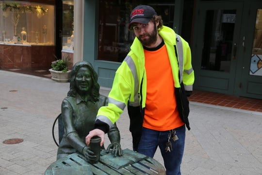 Taylor Carman, a building ground maintenance employee for the City of Ithaca Parking Division, found the cup that was taken from the Child of Ithaca statue.