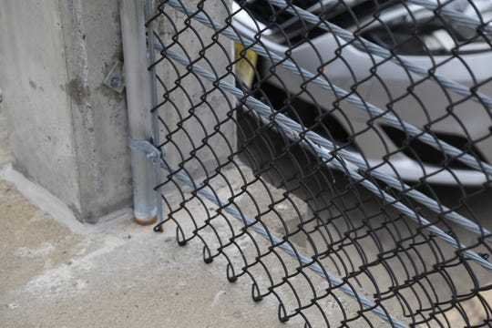The cup from the Child of Ithaca statue was on this ledge behind a fence on top on the upper deck of the Green Street Parking Garage when Taylor Carman discovered it.