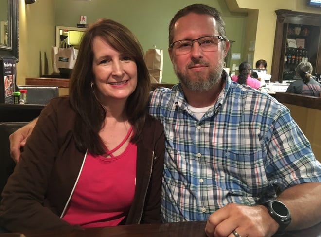 Jim and Julia Daniels take a picture while out to eat before his accident nearly a year ago.