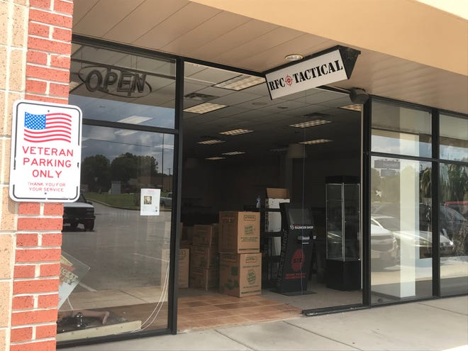 Boxes of inventory are stacked in RFC Tactical gun shop in Milan on Friday, May 24. The business was sold and proceeds will be used to fill back-orders from owner Justin Scott's other business, the Rustic Flag Company.