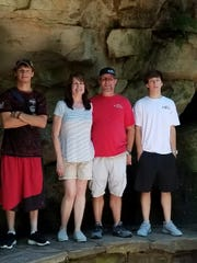 The Daniels family - James, Julie, Jim and David - got a pic while on a trip to Rock City in Chattanooga two years ago.