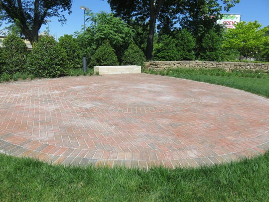 A flat brick stage-like area on the east end of Everly Brothers Park.