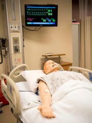 The SimMan advanced training mannequin lays inside a replica of an ER room at UTMC.