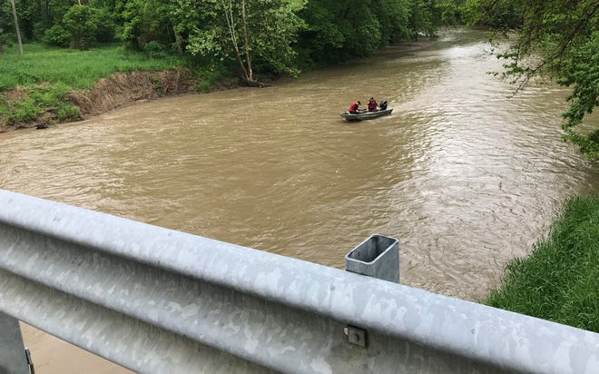 Rescue workers from the Indiana Department of Natural Resources and other local agencies were in boats, using sonar equipment, on Friday, May 24, 2019, in the search for a missing 4-year-old boy, who was swept away Thursday evening by the Deer Creek at Riley Park in Delphi. These two officers were about a half-mile downstream, at the south end of Riley Park, as seen from the Hamilton Street bridge.