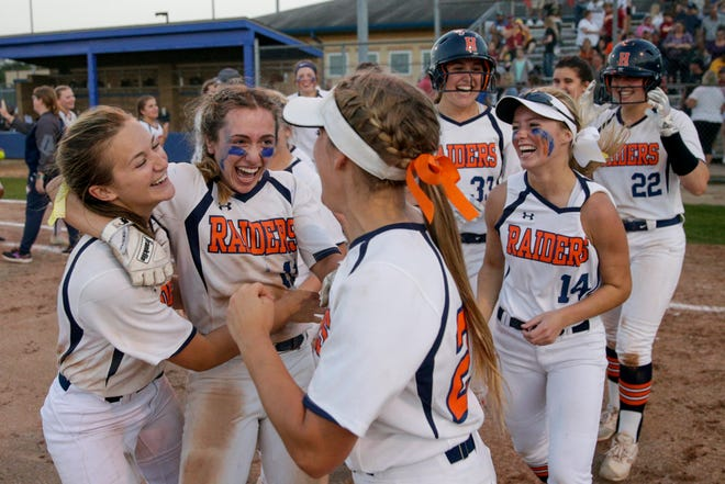 Harrison celebreates after defeating McCutcheon, 6-5, to win the 4a Softball Sectional championship, Thursday, May 23, 2019, in West Lafayette.
