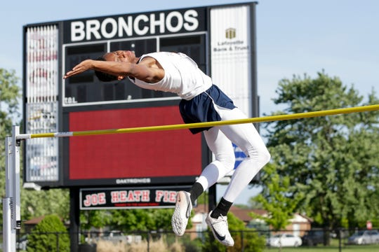 """Harrison's DeAndre Alsup clears 6'0"""" while competing in the high jump during the IHSAA Regional boys track meet, Thursday, May 23, 2019, in Lafayette."""