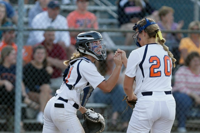 Harrison catcher Kiley Goff (11) and Harrison pitcher Abbott Badgley (20) celebrate during the fifth inning of the 4a softball Sectional championship, Thursday, May 23, 2019, in West Lafayette. Harrison won, 6-5.