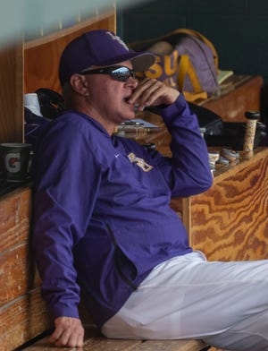 LSU head coach Paul Mainieri looks on during an LSU at Alabama NCAA college baseball game, Sunday, April 28, 2019, in Tuscaloosa, Ala. (AP Photo/Vasha Hunt)