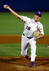 LSU's Cole Henry throws a pitch during the first inning of a Southeastern Conference tournament NCAA college baseball game against South Carolina, Tuesday, May 21, 2019, in Birmingham, Ala. (AP Photo/Butch Dill)
