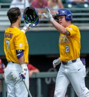 LSU outfielder Giovanni DiGiacomo (7) greets LSU outfielder Daniel Cabrera (2) after his home run trot during an LSU at Alabama NCAA college baseball game, Sunday, April 28, 2019, in Tuscaloosa, Ala. (AP Photo/Vasha Hunt)