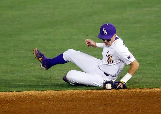 LSU second baseman Brandt Broussard makes a sliding grab on a grounder by South Carolina's Brady Allen during the second inning of a Southeastern Conference tournament NCAA college baseball game Tuesday, May 21, 2019, in Birmingham, Ala. (AP Photo/Butch Dill)