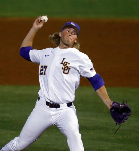 LSU's Matthew Beck throws a pitch during the second inning of the team's Southeastern Conference tournament NCAA college baseball game against South Carolina, Tuesday, May 21, 2019, in Birmingham, Ala. (AP Photo/Butch Dill)