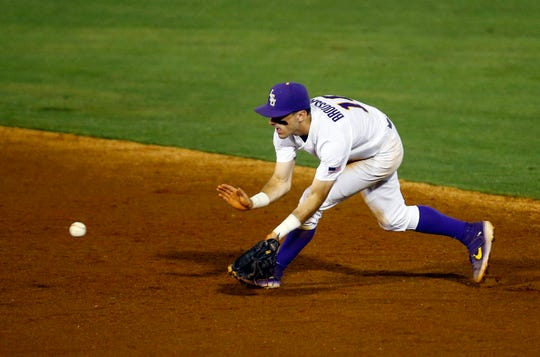 LSU second baseman Brandt Broussard fields ground ball from South Carolina's George Callil during the third inning of a Southeastern Conference tournament NCAA college baseball game Tuesday, May 21, 2019, in Birmingham, Ala. (AP Photo/Butch Dill)