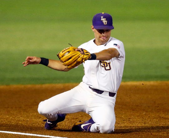 LSU third baseman Hal Hughes fields a ground ball from South Carolina's Cam Tringali during a Southeastern Conference tournament NCAA college baseball game Tuesday, May 21, 2019, in Birmingham, Ala. (AP Photo/Butch Dill)