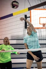 Joann Rebbin goes up at the net during volleyball practice for a team called 50 Shades of Grey. 5/22/19