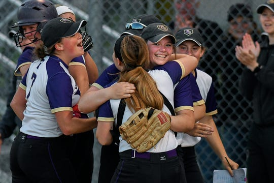 Fowlerville's Peyton Boden, right, hugs catcher Lindsey Darby following an out at the plate that ended a 3-1 victory over Fowler on Thursday, May 23, 2019.