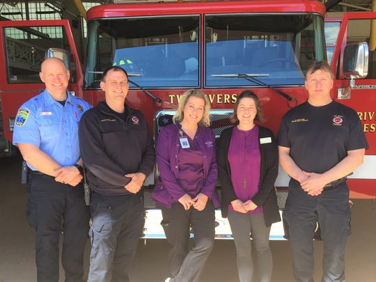 Sharon S. Richardson Community Hospice recently recognized Manitowoc and Two Rivers fire departments in recognition of EMS Week. Pictured are hospice staff with Two Rivers Fire Department personnel.