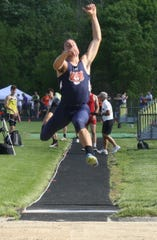 Galion freshman Hanif Donaldson wins a regional long jump title with a leap of 22 feet-4 inches at Lexington High School.