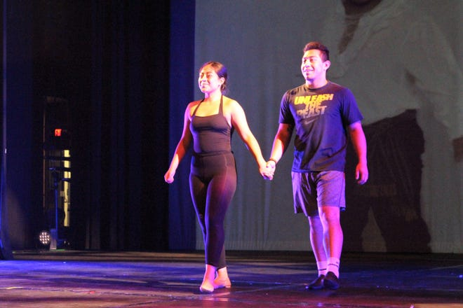 Olivia and Gabe Detwiler walk on stage during a Wednesday evening rehearsal for Edye Cook's School of Dance. Come this fall, the brother and sister will be living apart for the first time in nearly 18 years.