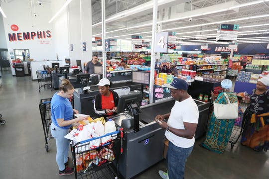 Shoppers visit the Save-A-Lot grocery store in the Binghampton Gateway Center, an addition that came last year to a neighborhood that was previously considered a food desert.
