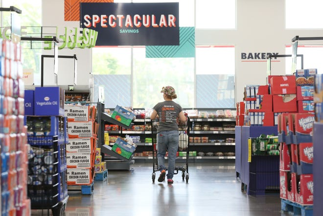 A shopper walks the aisles at Save-A-Lot grocery store in the Binghampton Gateway Center, an addition that came last year to a neighborhood that was previously considered a food desert.