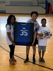 Tabatha Vail displays her son's custom Kentucky jersey at Academies of West Memphis High School.