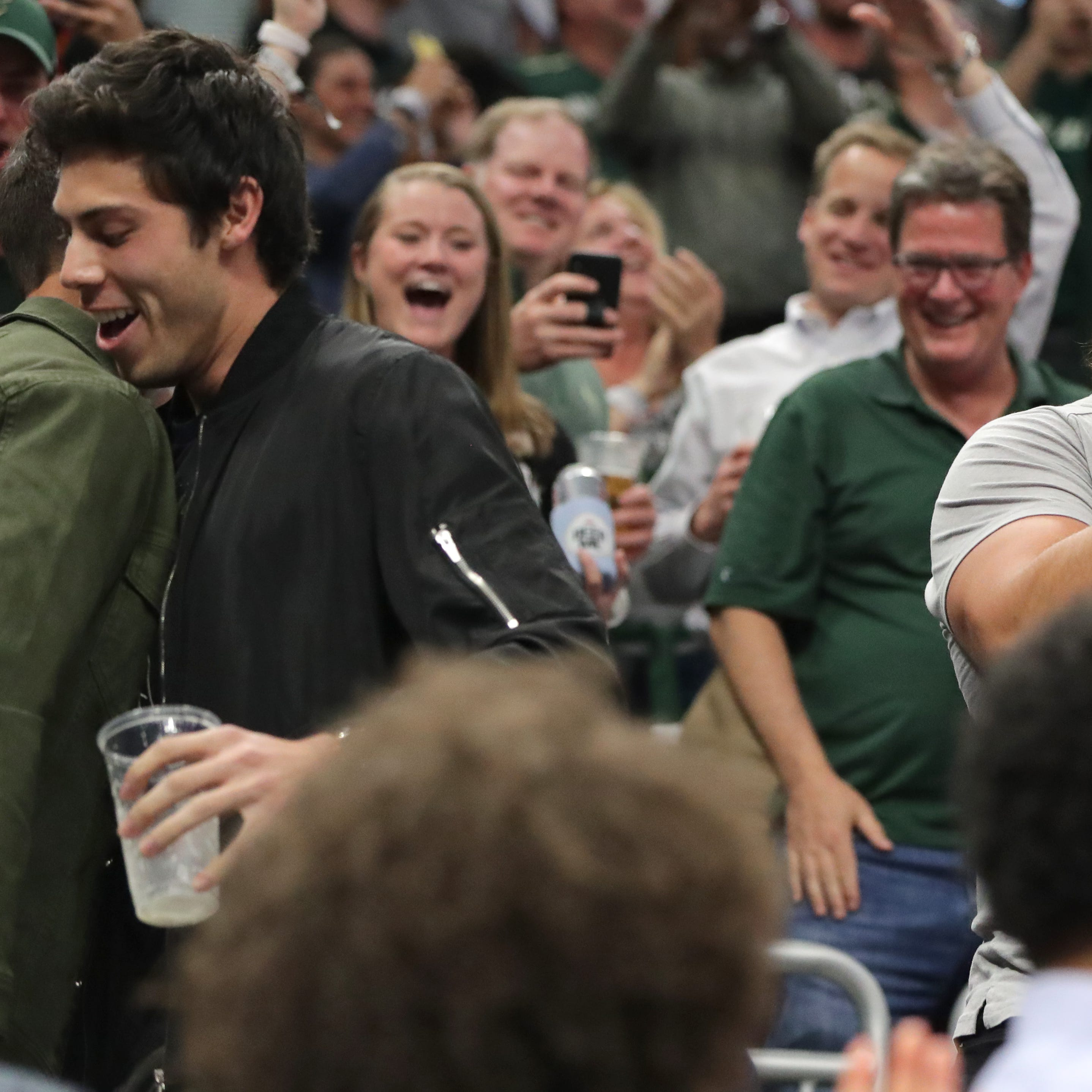 From courtside with 'Milwaukee's Drake' to the top of Fiserv Forum, Bucks fans sweat out Game 5