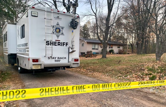 A Barron County, Wis., sheriff's vehicle is parked Oct. 23, 2018 outside the home where James and Denise Closs were found fatally shot on Oct. 15. The home was torn down Tuesday, Aug. 6.