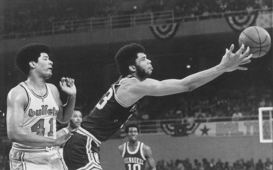 Lew Alcindor reaches for a loose ball as Baltimore Bullets star Wes Unseld can only watch in a dominating performance by the Bucks in Game 4 of the NBA Finals on April 30, 1971.
