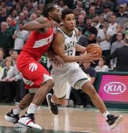 Bucks guard Malcolm Brogdon (right) is a restricted free agent, meaning the Bucks have a chance to match any contract offer he gets elsewhere.