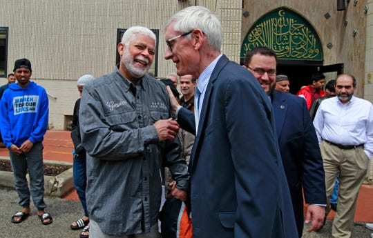 Abdelfattah Elewa, left, greets Gov. Tony Evers at the Islamic Center of Wisconsin after speaking with worshippers.