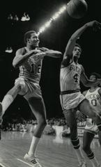 Bucks forward Greg Smith swats away a layup by Baltimore Bullets' John Tresvant during Game 1 of the 1971 NBA Finals. The Bucks won, 98-88.