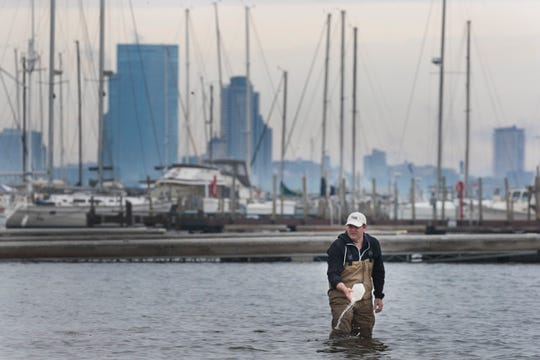 Todd Miller, associate professor at the University of Wisconsin-Milwaukee's Zilber School of Public Health, samples water at South Shore Park in Milwaukee on May 24. Miller was testing for E. coli, pharmaceuticals, personal care products, recreational drugs, and other pollutants.