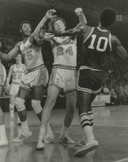 The Bullets' Jack Marin (24) and Bucks forward Bobby Dandridge  square off in the  Game 4. Both received technical fouls but neither was ejected and the Bucks won, 118-106, to take the NBA title.