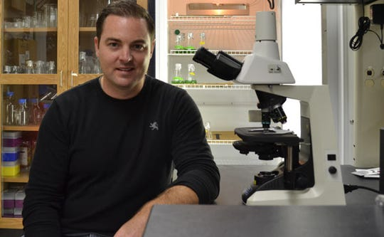 Todd Miller, a microbiologist and associate professor at the University of Wisconsin-Milwaukee's Zilber School of Public Health, fears that global warming could lead to the growth of the harmful algae in Michigan and other Great Lakes.