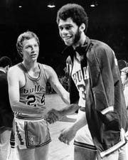 Bucks center Lew Alcindor is congratulated by Baltimore Bullets' Jack Marin after the Bucks won Game 3 of the 1971 NBA Championship series,107-99, on April 28, 1971, at the Milwaukee Arena. Alcindor scored 23 points and pulled down 21 rebounds in the victory, which put the Bucks within one game of winning the NBA title.