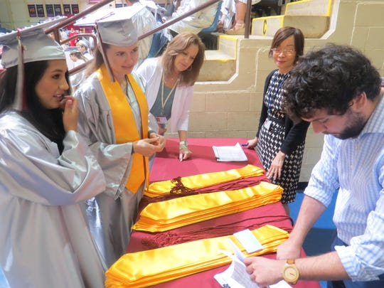Graduates check in at the Mennen Arena in Morris Township for the County College of Morris 2019 commencement. May 24, 2019