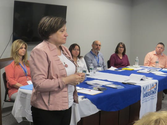Ann Portas, assistant division director of the New Jersey division of mental Health, speaks to parents, friends and legal guardians of patients committed to Greystone Park Psychiatric Hospital participate during a family forum hosted by the Mental Health Association of Essex and Morris in Parsippany. May 22, 2019.