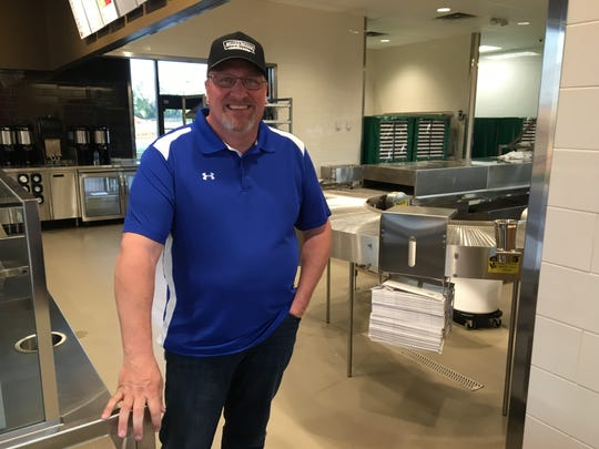Mike Losey, district manager with Krispy Kreme, stands in the kitchen of the Murfreesboro store, which will open June 4.