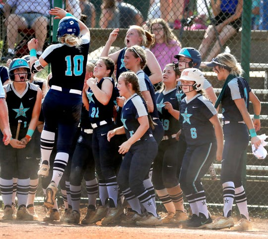 Siegel's Caitlyn McCrary (10) celebrates at home plate with her team after hitting the second of two home runs during the Class AAA state championship game against Jefferson County on Friday.