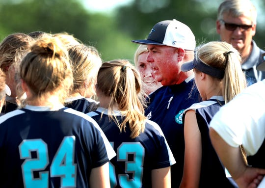 Siegel's head coach Shawn Middleton talks to his players after beating Jefferson County during the Class AAA State Girls Softball first Championship game and before the second Championship game on Friday, May 24, 2019, on the last day of Spring Fling, in Murfreesboro.