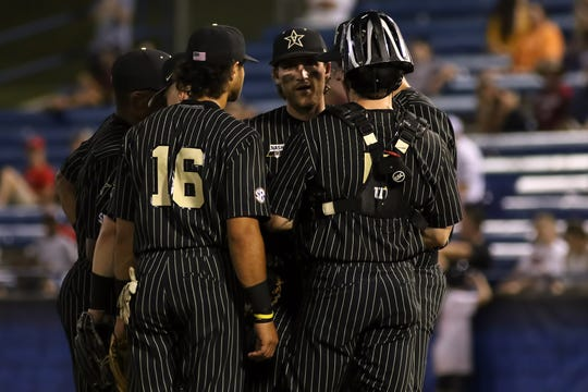 Vanderbilt infielders talk at the mound during a 1-0 win over Mississippi State Thursday in the SEC Baseball Tournament in Hoover, Ala.