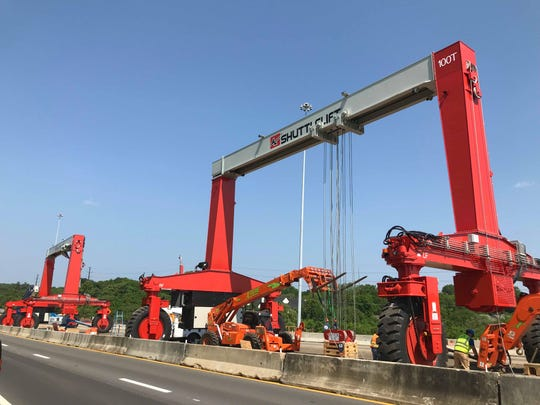 Two of the giant gantry cranes being used for the Reconstruction Project are pictured here.