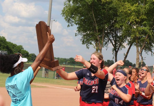 Columbia Academy's Brittany Adair accepts the Class A state softball championship on Friday. Columbia Academy defeated Summertown 3-0.