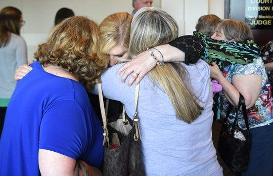 Burnette Chapel Church of Christ members and relatives of victim Melanie Crow hug after the verdict in the trial of Emanuel Samson on Friday.