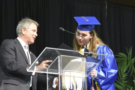 Sen. Kerry Roberts recognizes Valedictorian Trish Nguyen and Salutatorian Ben Bruzewski at Harpeth High School's graduation ceremony at Lipscomb University's Allen Arena in Nashville on Thursday, May 23.