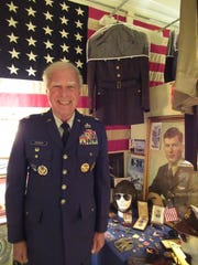 Naples resident Stephen Pedone with some of his family's war memorabilia
